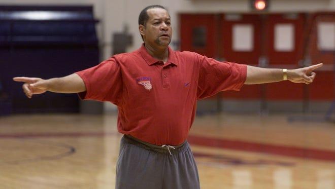 Detroit Mercy basketball coach Perry Watson directs his players Nov. 9, 2004, at Calihan Hall.