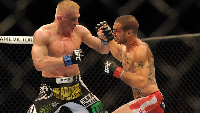 Cub Swanson, right, defeated Dennis Siver during their featherweight bout in July.