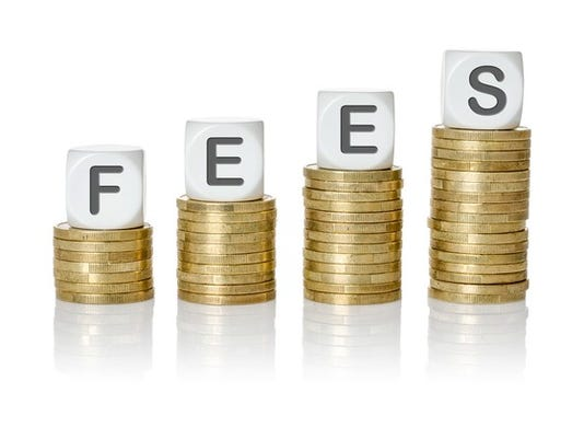stack-of-coins-with-the-word-fees-gettyimages-511875092_large.jpg