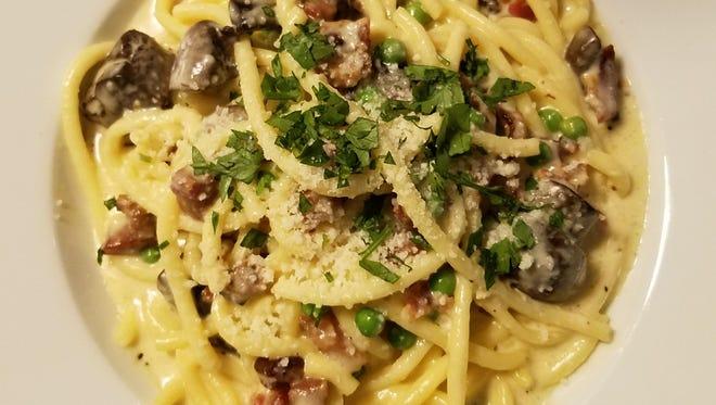 Drift Kitchen & Bar's Bucatini Carbonara was pasta with Pecorino Toscano cream sauce enhanced by crispy pancetta, sweet green peas, Cremini mushrooms, and Applewood smoked bacon.