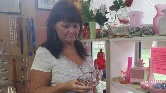 Pam Bowman of Cape Canaveral shops at the Cocoa Beach Community Church Thrift Shop.