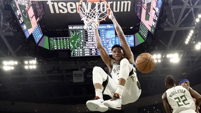 The Milwaukee Bucks' Giannis Antetokounmpo dunks during the first half of a  game against the Philadelphia 76ers on Feb. 22 in Milwaukee.