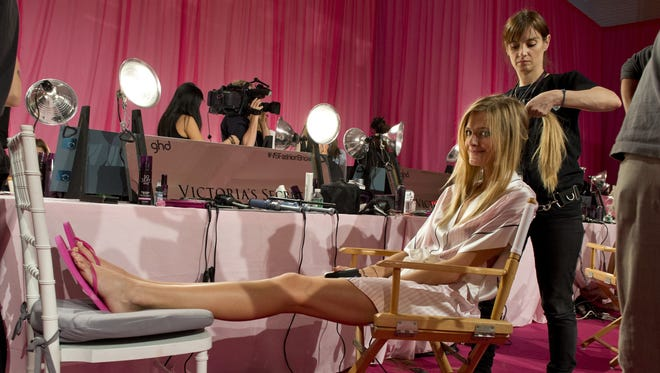 Model Constance Jablonski takes a relaxed approach as she gets her hair done by Tania Becker.