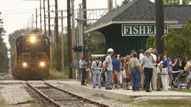 The Indiana Fair Train operated by the Indianapolis Transportation Museum, pulls into the Fishers train station to drop off and pick up passengers heading for the Indiana State Fair Saturday, Aug. 9.