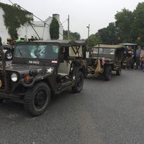 Military vehicles line up for the start of the 75th annual Hyde Park Independence Day parade.