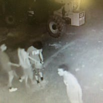 Video surveillance image shows four suspects believed to have set fire to an apartment building under construction on Haywood Road.