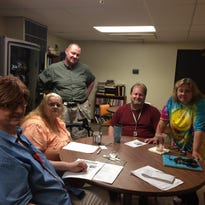 Deeanna Wooden, Sandy Towne, John Allen, Mark Jordan and Kathy Kobiska, all residents of Carriage Lane Apartments in Okemos talk about food cuts Friday, July 23, 2015. Wooden and Kobiska had their assistance restored this week after calls from the Lansing State Journal.