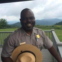 Smokies superintendent Cassius Cash speaks with a group of students on a field trip to the Great Smoky Mountains Institute at Tremont. Cash, who began his job in February, said one of his main goals is to encourage more youth to visit the park.