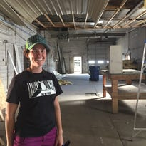 Abby Thompson stands inside the building at 608 1st Ave. S. that will become the Hi-Line Climbing Center. Thompson and her husband Brian hope to open the climbing gym by November.