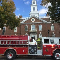 Firefighters work Wednesday at Legislative Hall in Dover.