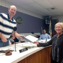 Retiring Village of Milford Planning Commissioner Kathy Amerman accepts a certificate of appreciation from Village Council President Jerry Aubry during a recent meeting.