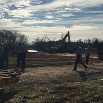 Highway Patrol stand on the scene where a vehicle chase Wednesday ended in a construction site on Long Shoals Road.