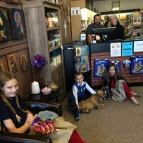 Jeff and Kris Zdroik, co-owners of Gifts of Grace, pose in their store along with three of their children, Gemma, Joseph and Jacinta.