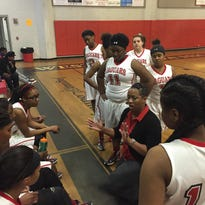 West Florida coach Iesha Stallworth-Ridgeway regroup during a timeout during Thursday's 62-50 playoff win over Marianna.