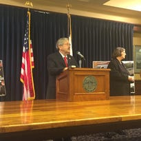 Gov. Terry Branstad addresses reporters July 25.