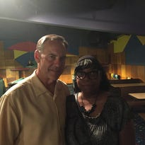 Michigan State coach Mark Dantonio spent a lot of personal time with Dale Harvel's widow, Bridgett, right, at a tribute in Warren on Thursday.
