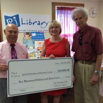 Left to right: Lew Sims, president of the Harding Club; Melinda Margulies, PJ Library program director and Howard Lynne, president of the Jewish Federation of Dutchess County.