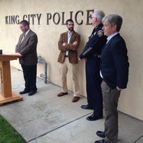 King City City Manager Michael Powers (left) prepares to announce Tony Sollecito as interim police chief. Mayor Robert Cullen and Council Member Mike LeBarre flank Sollecito.