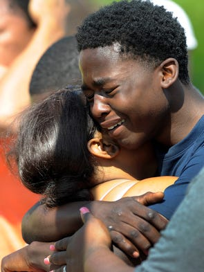 Crystal Mitchell, left, the mother of Deontae Mitchell,