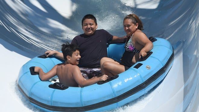 In this file photo, Ross Ramirez, right, of Newburgh goes down a waterslide with her son Marcos Martinez, center, and nephew Domenick Ramirez, left, at SplashDown Beach Water Park in Fishkill.