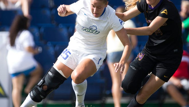 FGCU's Tabby Tindell (25) dribbles the ball as Lipscomb's Niamh Rawlins defends in the first half of action in the ASUN Championship Final at the FGCU Soccer Complex Sunday, November 6, 2016 in Estero. FGCU would defeat Lipscomb 2-0 clinching an NCAA tournament berth.