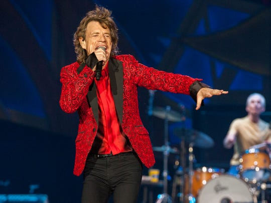 In this July 4, 2015 file photo, Mick Jagger of the Rolling Stones performs at the Indianapolis Motor Speedway in Indianapolis, Ind. Jagger's representatives say the rock legend is expecting his eighth child. The representatives confirmed a report by People magazine and other media outlets that Jagger's girlfriend, Melanie Hamrick, 29, is pregnant.