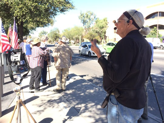 A small group of armed protesters, led by Roy Warden, lined up outside Tuscon federal court on March 4, 2016, demanding justice for an Arizona rancher shot and killed by authorities during the siege of an Oregon wildlife refuge.