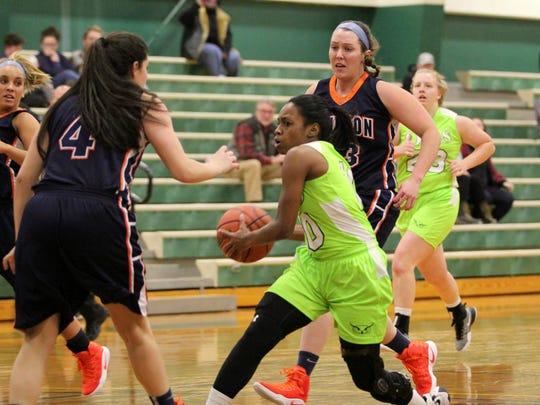 Danasia Dumas drives to the basket against Johnson