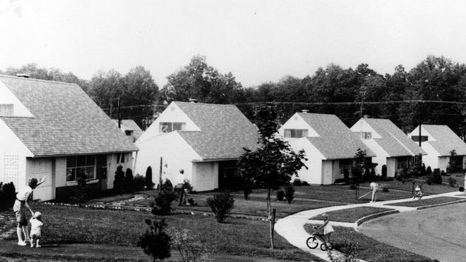 Levittown, N.Y., shown in 1958, was one of many postwar suburbs built with federal subsidies that were designed to create all-white communities.