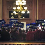 HJR-3  opponents stand outside the Indiana House   of Representatives on Jan. 27 . The House voted 52-43 to strike the second sentence from the measure .