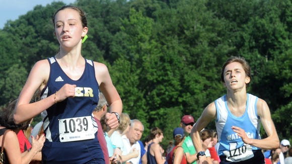 Roberson senior Lily Anderson, left, has committed to run in college for Dartmouth.