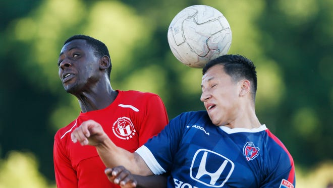 Halid Apoudjak of FC Indiana, left, and Jose Rodriguez of Indy Eleven battle for control of the ball Wednesday, June 29, 2016, at Legacy Sports Club, 2920 Conservation Club Road in Lafayette. FC Indiana fell to Indy Eleven 6-2.