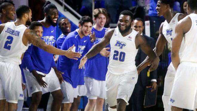 MTSU's Giddy Potts (20) celebrates coring a basket with his team during the game against Vanderbilt on Thursday, Dec. 8, 2016, at MTSU.