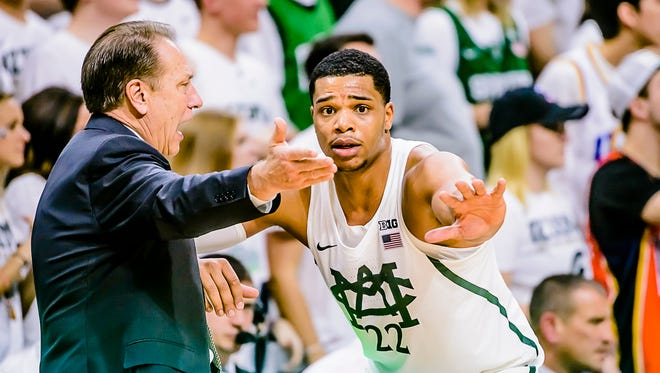 Miles Bridges ,right, of MSU attempts to explain how he was charged with a foul to MSU head coach Tom Izzo during their game with Wisconsin.
