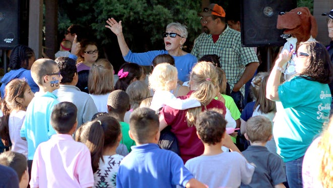 Bettye Ricks (center) leads a group of children in Camp Fire songs for their parents during the organization's annual Fall Family Fun Night at Harrell Park. There is still time to register for the camp's last session beginning June 19. After that camp, the pool at Harrell Park will be open six days a week through the summer.