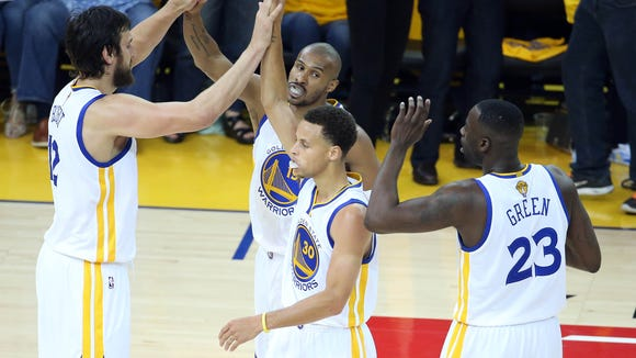 June 7, 2015; Oakland, CA, USA; Golden State Warriors guard Leandro Barbosa (19) celebrates a scoring play with center Andrew Bogut (12), guard Stephen Curry (30) and forward Draymond Green (23)against the Cleveland Cavaliers during the first half in game two of the NBA Finals at Oracle Arena. Mandatory Credit: Kelley L Cox-USA TODAY Sports ORG XMIT: USATSI-225714 ORIG FILE ID: 20150607_gav_ax5_034.jpg
