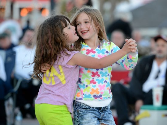 Cousins Chloe Beamer, left, and Madelyn Hughes dance at the Gulfside Pavilion on Pensacola Beach during a previous Bands on the Beach season. The 2017 season opens Tuesday.