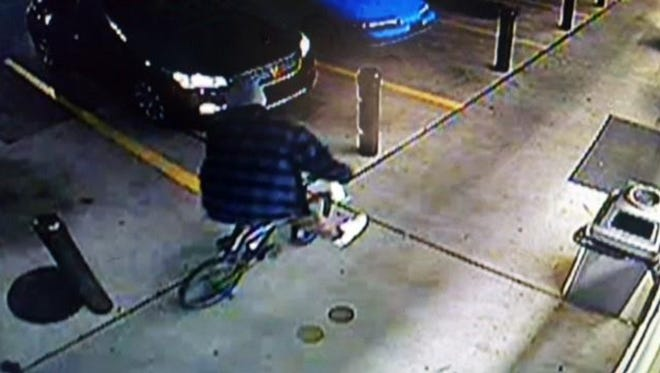 Simpsonville police hope surveillance photos will help them identify the person responsible for an armed robbery at a 7-Eleven store on Harrison Bridge Road.