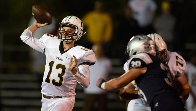 Central quarterback Brennon Harper fires a pass to a teammate during the second quarter of sectional semifinal game against Reitz at the Reitz Bowl in Evansville Friday.