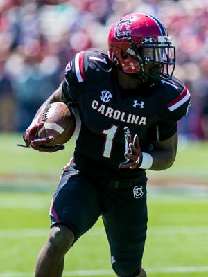Black Team wide receiver Deebo Samuel runs after the reception during the 2016 Garnet & Black Game at Williams-Brice Stadium in Columbia, SC.