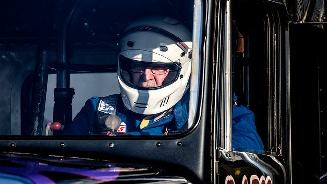 79-year-old Bob Matz prepare to race his semi truck down the track at National Trail Raceway at the annual Night of Thunder event.