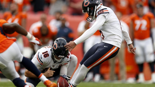 Chicago Bears kicker Eddy Pineiro (15) kicks the game-winning field goal as punter Pat O'Donnell (16) holds in a game against the Denver Broncos on Sunday, Sept. 15, 2019, in Denver. The Bears won 16-14.