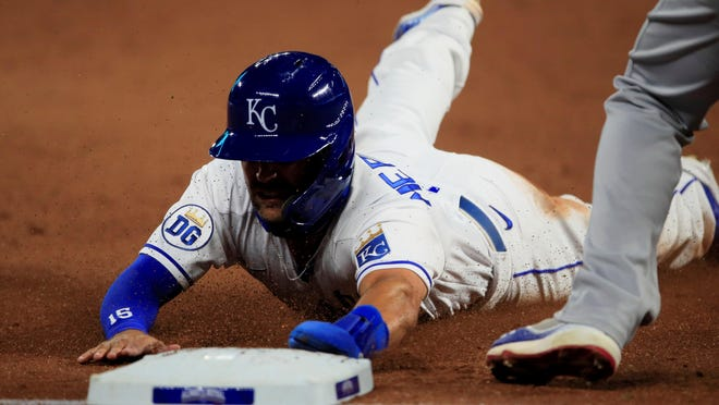 Whit Merrifield of the Kansas City Royals slides into third base during the sixth inning Wednesday night at Kauffman Stadium. Merrifield was stranded on third in the Royals' 6-1 loss to the Chicago Cubs.