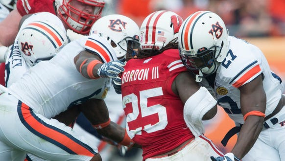 Auburn defensive back Robenson Therezie (27) tackles
