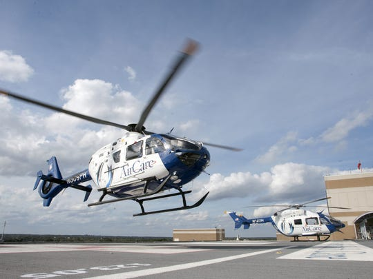 One of the University of Mississippi Medical Center's AirCare helicopters lands on top of the Medical Center, transporting a patientfrom another hospital.