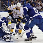 Tampa Bay Lightning goalie Andrei Vasilevskiy makes a save on a shot by the Predators Colin Wilson in the first period. Helping out is Lightning defenseman Jason Garrison.