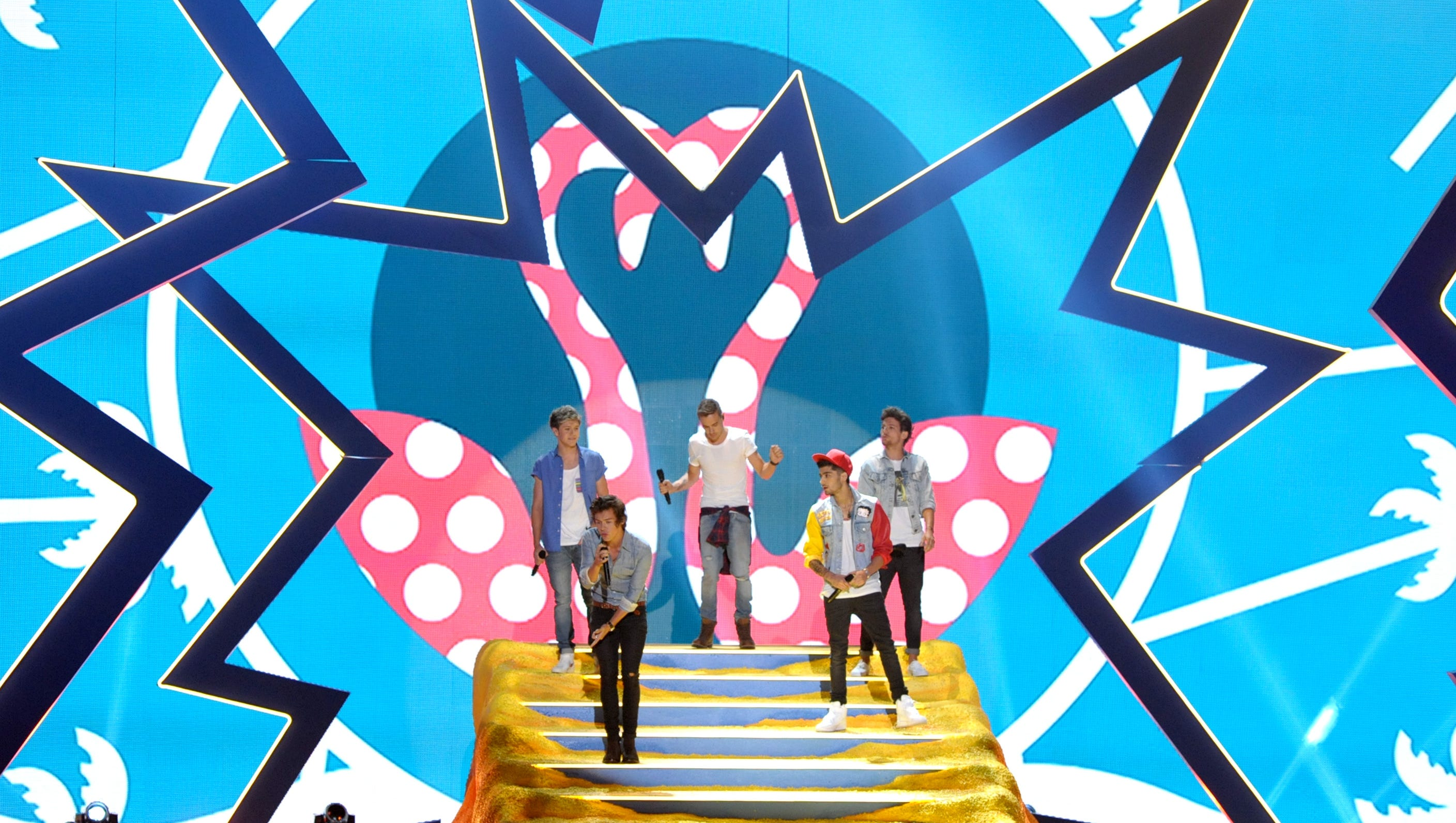 Niall Horan, from left, Harry Styles, Liam Payne, Zayn Malik and Louis Tomlinson of the musical group One Direction perform.
