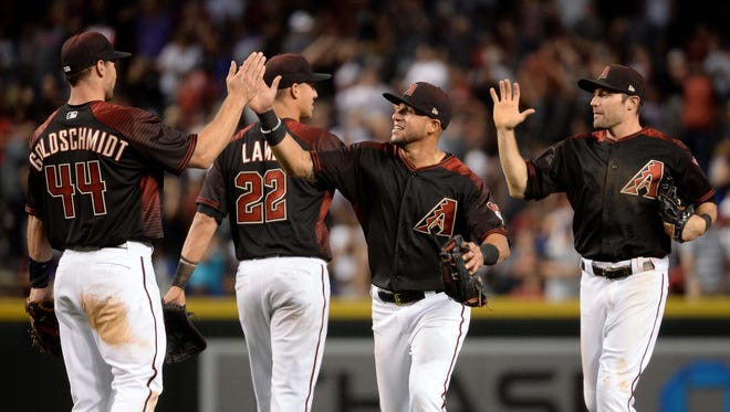 Apr 22, 2017: Arizona Diamondbacks Paul Goldschmidt (44), Jake Lamb (22), David Peralta (6) and A.J. Pollock (11) celebrate after defeating the Los Angeles Dodgers at Chase Field. The Arizona Diamondbacks won 11-5.