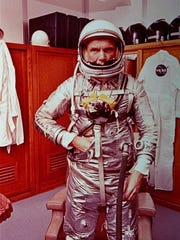AP File Astronaut John Glenn stands in his space suit February 1962. Before he launched into space, Glenn, who had a squeaky clean reputation as a pilot, trained for flying in Corpus Christi.