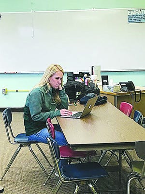 Stephanie Thompson videoconferences to develop a distance-learning plan for her students at USD 382 Pratt.